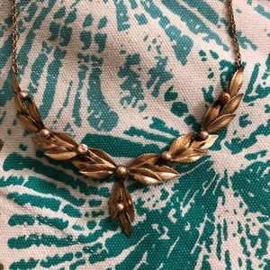 Leaf accented necklace